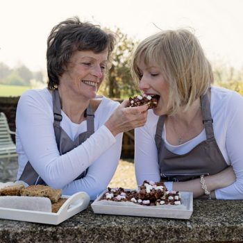women eating brownies