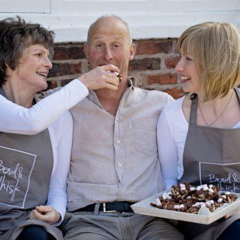 3 people eating cake