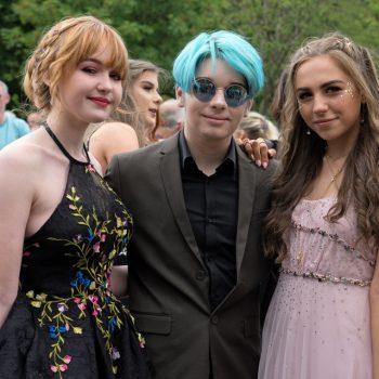 three prom students